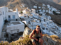 Robby poses atop the pinnacle of Hora, with a gorgeous background of cube-shaped houses, churches, and steep staircases