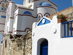We love Greece's white/blue color scheme, and it looks lovely on this church