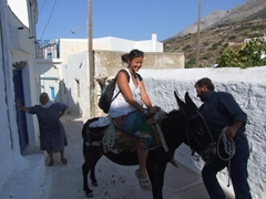 Becky laughing at her inability to get the donkey to move; impromptu donkey ride in Langada