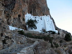 The Hozoviotissa monastery's dazzling white facade clings to the cliff face on Amorgos's east coast