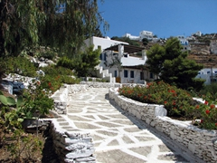 A typical example of a brilliant, white washed home nestled in the foothills of Ios