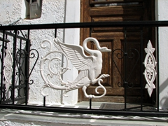 Swan detail on a wrought iron balcony