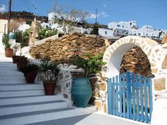 A quaint staircase leads down to a popular eatery; near Mylopotas