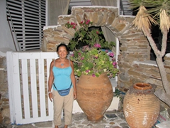 Ann stands by the entranceway to Markos Beach Hotel; Mylopotas