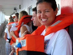 Becky listens carefully to the Easy Cruise safety drill