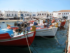 Colorful fishing boats line the harbor in Hora