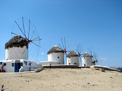 Mykonos's windmills are an icon of the island. They are used as houses and rental units, perched on a hill between the picturesque Hora and its parking lot