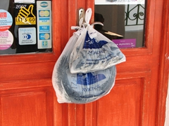 Talk about fresh fish! Tied up in plastic bags on a door in Hora