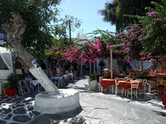 A bougainvillea-shaded restaurant does brisk business in Hora