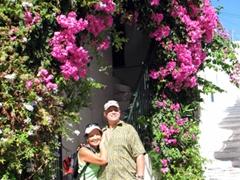 Awww, how romantic! Ann and Bob strike a pose under a pretty bougainvillea arch