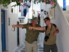Bob and Robby are pointing to where they bought the latest bottle of ouzo