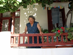 Panos's lovely grandma looks on with concern at the four drunk Americans at her doorstep