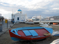 Colorful fishing boat docked on the town beach in Hora