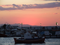 Sunsets in Greece are always beautiful with brilliant oranges fading to pink and purple hues