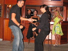 Dario commands everyone's attention as he begins salsa lessons at the Sun/Moon Bar; Easy Cruise