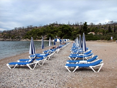 Empty sunning beds at Agio Anargyri Beach (the weather was somewhat overcast today, perhaps explaining the absence of of people?)