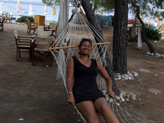 Becky chilling on a hammock at Vrellas Beach