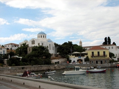 The pretty Monastery of Agios Nikolaos stands above the Old Harbor