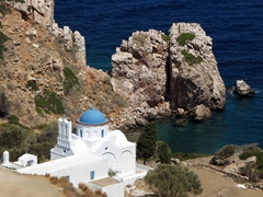 The gorgeous church of Panagia Poulati is built on a rocky elevation with fine vistas to the sea. It is surrounded by olive trees