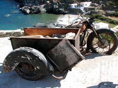 This sidecar motorcycle appears to have been here for a while; Kastro