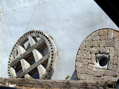 Old fashioned grindstone in Kastro