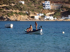 Local kids playing on their boat in Vathi Bay