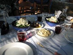 Red wine, Greek salad (topped with arugula and mizithra...a Sifniot cheese that is less sharp than feta and has the consistency of cottage cheese), and eggplant dip...a great starter