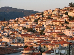 The sun's setting rays lit up the entire skyline of Poros Town with a nice orange hue
