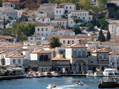 Hydra's waterfront is a buzz of activity with water taxis and fishing boats zooming in and out at high speed
