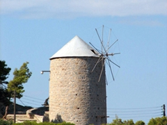 An old windmill perched at the entrance to Hydra Town