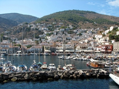 Hydra Town's buildings form an amphitheater around the famously picturesque harbor, with the opening facing north. Yachts and fishing boats bob in the center