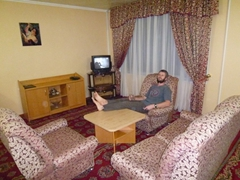 Robby relaxes in the living room section of our room at Hotel Poytakht; Dushanbe