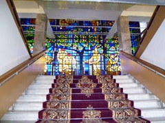 A stained glass mural depicting laborers greets visitors heading up to the second floor of Hotel Poytakht