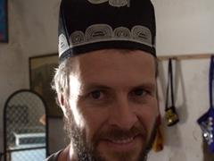 Robby tries on a Tajik skull cap; Hisor Fort