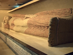 A replica of the famous 13 meter long reclining Buddha (the original 1600 year old Buddha in Nirvana is housed at the Museum of Antiquities in Dushanbe but photos aren't allowed); National Museum