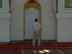 A worshipper prays towards Mecca; Jami Mosque in Khujand