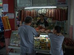 Sausage seller; Khujand Bazaar