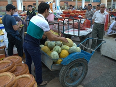 Be careful around the men and boys with wheelbarrows as they quickly plow their way through the Khujand Bazaar