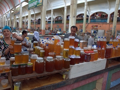 Rows and rows of fresh honey for sale (this vendor was eager for us to taste how delicious it is); Khujand Bazaar