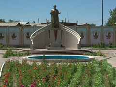 "Garden statue of Rudaki (Tajikistan's very own ""Shakespeare""), flanked by great Tajik poets and writers on the wall behind; Istaravshan"