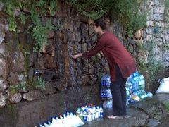 Becky cools down with glacial water runoff (used by entrepreneurial vendors to cool their drinks for sale)