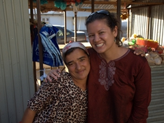 A friendly Tajik girl happily embraces Becky, overjoyed at meeting an American; Ayni