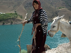 A lady leads her donkey past the 4th Lake, Marguzor