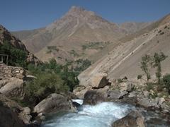 A view of the gushing Shing River; Fann Mountains