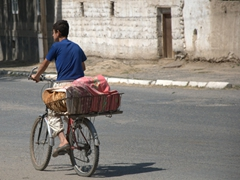 A boy transports naan; Ayni