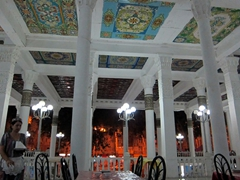 Open air seating at the popular Choikhona Rokhat restaurant in Dushanbe. The painted ceiling is in Persian style and the waitresses are dressed in traditional garb