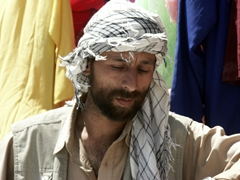 Close up of a vendor at the Bagram Bazaar