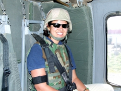 Becky smiles broadly on a helo ride from Kabul to Bagram
