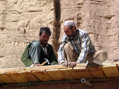Two laborers engrossed in their work; Bamiyan