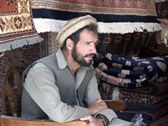 Profile of a carpet seller; Bagram Bazaar